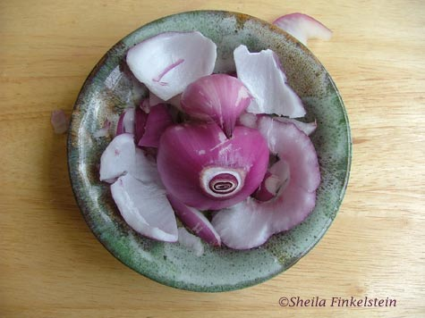 red onion in dish with all the pieces peeled from layers 7