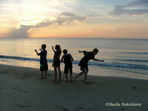 Children celeberating sunrise at Boynton Beach